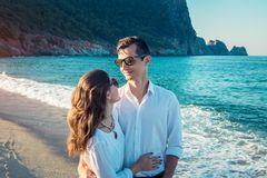 Young happy couple hugging on tropical beach Stock Photography