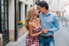 Young happy couple hugging while walking on the street. stock photos