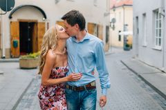 Young happy couple hugging while walking on the street. stock images