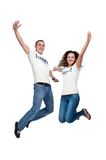 Young happy couple jumping up. Isolated on white Stock Photo