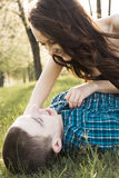 Young happy couple kissing. On the grass Royalty Free Stock Photos
