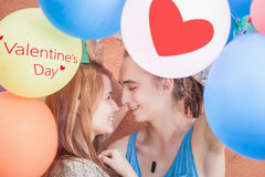 Young happy couple kissing and holding balloons Stock Photo