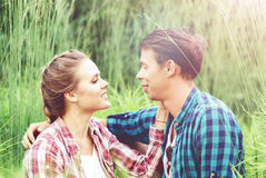 Young and happy couple kissing in park. Love, relationship, roma Stock Photography