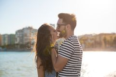 Young happy couple kissing at seaside. Portrait of young happy couple kissing at seaside Stock Images