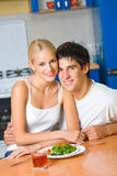 Young happy couple at kitchen Stock Photos