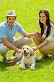 Young happy couple with Labrador dog Royalty Free Stock Photos