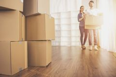 The young happy couple looking around their new apartment. Moving, purchase of new habitation stock photography