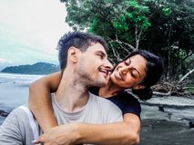 Happy young romantic couple in love looking each other in the eye. stock photography