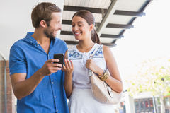 Young happy couple looking at mobile phone Royalty Free Stock Photography