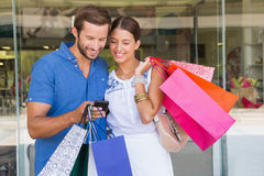 Young happy couple looking at mobile phone Stock Image
