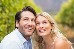 Young happy couple looking in the sky Stock Photos