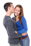 Young Happy Couple in Love. A young happy man and woman couple in love kissing royalty free stock images