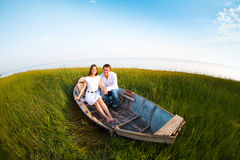 Young happy couple in love in a boat Stock Image