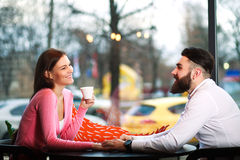 Young happy couple in love in cafe holding hands Royalty Free Stock Photos