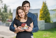 Young happy couple in love is dreaming and planning a new house.  Stock Photos