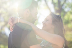 Young happy couple in love embracing in sunlight. Portrait of young happy couple in love embracing in sunlight Royalty Free Stock Photography