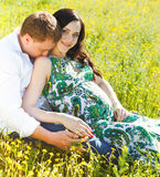 Young happy couple in love in the flowering spring park Royalty Free Stock Photos