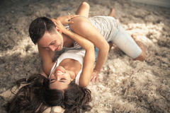 Young happy couple in love. Many feathers on the floor. Young happy couple in love. Romantic. Many feathers on the floor Stock Photo