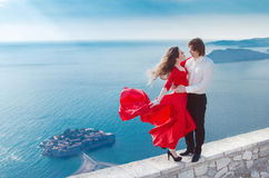 Young happy couple in love outdoor, Sveti Stefan, Montenegro. At Royalty Free Stock Images