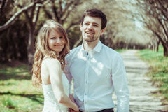 Young happy couple in love outdoors. loving man and woman on a walk at spring park. Young happy couple in love outdoors. loving men and women on a walk in a Royalty Free Stock Photo