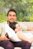 Young happy couple in love relaxing lying on the Royalty Free Stock Image