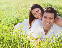 Young happy couple in love in spring day. Outdoors potrait stock photo
