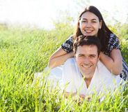 Young happy couple in love in spring day. Outdoors potrait royalty free stock image