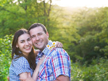Young happy couple in love in spring day. Outdoors portrait stock image