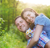 Young happy couple in love in spring day. Outdoors portrait stock photo