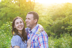 Young happy couple in love in spring day. Outdoors portrait royalty free stock photo