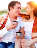 Young happy couple in love at the summer picnic Stock Image