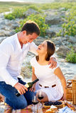 Young happy couple in love at the summer picnic Royalty Free Stock Image