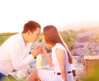 Young happy couple in love at the summer picnic Stock Images