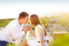 Young happy couple in love at the summer picnic Stock Photo