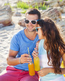Young happy couple in love at the summer picnic Stock Photos