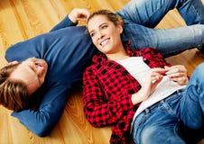 Young happy couple lying on the floor Stock Photo