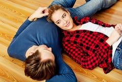Young happy couple lying on the floor Stock Image
