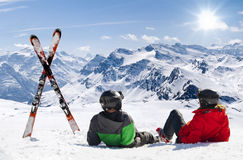 Young happy couple lying in snowy mountains Stock Photo