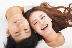 Young happy  couple  lying together Royalty Free Stock Photos