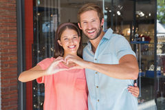 Young happy couple making a heart with their hands Royalty Free Stock Photo