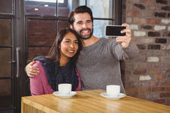 Young happy couple making a selfie Royalty Free Stock Photos