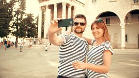 Young happy couple making selfie on vacation. Young happy couple making selfie stock footage
