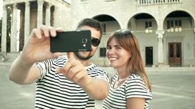 Young happy couple making selfie on vacation. Young happy couple making selfie stock video