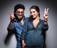 Young happy couple making the victory  sign Stock Images