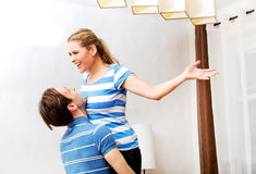 Young happy couple - man carrying woman Stock Photo