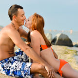 Young happy couple man and woman lying on sandy beach Royalty Free Stock Photography