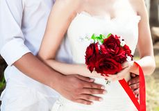 Young happy couple of man and woman in white. stock photos