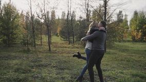 Young happy couple meet in the autumn park. HD stock video footage