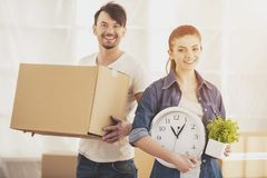 The young happy couple. Moving, purchase of new habitation royalty free stock images
