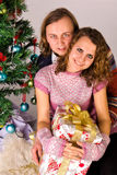 Young happy couple near a Christmas tree Stock Image